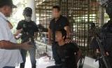 Polisi Malaysia menangkap empat orang yang merencanakan serangan teror skala besar terhadap tempat ibadah non-Muslim dan tokoh penting.