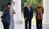 Presiden Joko Widodo saat menerima kunjungan Presiden Komite Olimpiade Internasional (IOC) Thomas Bach dan Presiden Komite Olimpiade Asia (OCA) Syeikh Ahmad Al-Fahad Al-Sabah di Istana Kepresidenan Bogor, Jawa Barat, Sabtu, (1/9).