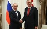 Presiden Rusia Vladimir Putin dan Presiden Turki Recep Tayyip Erdogan.