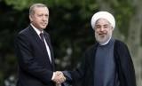 Presiden Turki Tayyip Erdogan (kiri) dan Presiden Iran Hassan Rouhani.