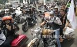 Ribuan anggota Harley Davidson Club Indonesia (HDCI) sedang berkumpul di Bandung.