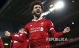 Selebrasi Mohamed Salah setelah mencetak gol kemenangan Liverpool di Stadion Anfield, Sabtu (30/12)