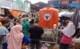 Semen Padang distribusikan tandon air untuk 10 pasar demi antisipasi penyebaran corona.