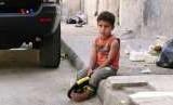 Seorang anak di kawasan pengungsian korban konflik di Palestina