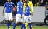 Striker timnas Italia, Lorenzo Insigne (kanan) pada laga playoff kualifikasi Piala Dunia 2018 lawan Swedia di Stockholm, Sabtu (11/11) dini hari WIB.