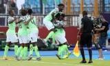Timnas Nigeria merayakan kemenangan atas Guinea