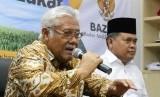 Wakil Ketua BAZNAS Zainulbahar Noor (kiri).