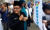 Walikota Malang, Sutiaji meluncurkan e-retribusi pelayanan pasar sekaligus membuka Festival Pasar Rakyat di Pasar Besar Kota Malang, Selasa (13/11).
