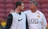 Wayne Rooney dan Sir Alex Ferguson saat masih sama-sama di Manchester United.